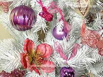 detail of a Xmas tree decorated with pink ornaments