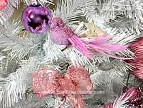 Detail of a bird on a Christmas tree, white colored
