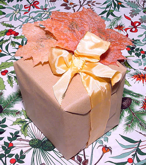 a packet with autumn leaves and a silk ribbon
