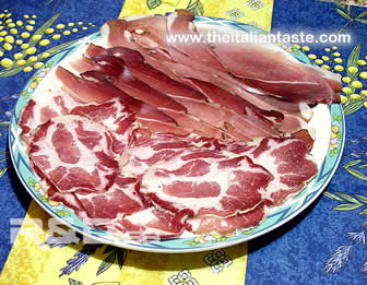 italian salami, the photo shows how Italian arrange salami in the serving dish, a typical example of antipasto platter