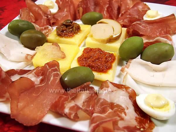 Italian antipasto platter with cold cuts and canapes for Italian canape ideas