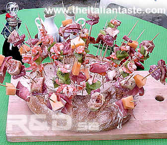 assorted salami and fruit on skewers