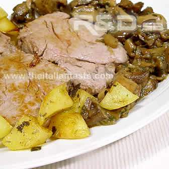 Veal fillet with potatoes and mushrooms in serving plate